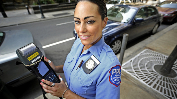 Will Self-Driving Vehicles Ever Be Able to Replace Human Meter Maids?